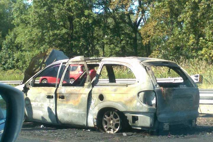 The remains of the car that caught fire on Route 80 West Friday afternoon