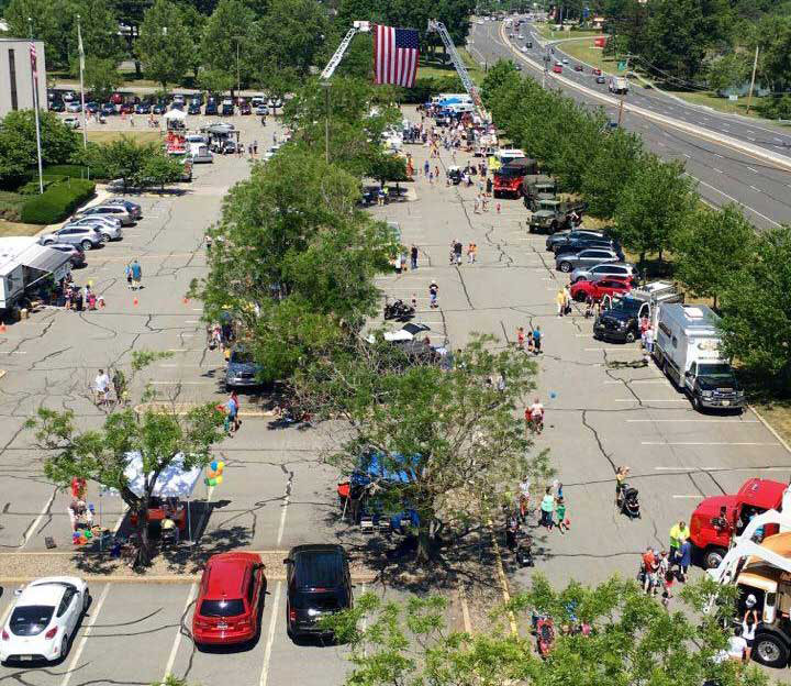 A view from above of all the vehicles at Kiwanis Club Touch-A-Truck